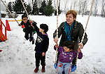 Mirjana Cosic, director of the Nasa Radost preschool for Roma children in Smederevo, Serbia, plays with Roma children whose families were displaced by cold weather and took refuge at a Red Cross shelter. Church World Service supports both the preschool and the shelter.
