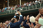 June 13, 2015 Ahmed Zayat of Zayat Stables holds the Triple Crown winner's trophy for American Pharoah, who won the 2015 running of the first jewel of the Triple Crown at Churchill Downs.  ©Mary M. Meek/ESW/CSM