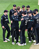 20th March 2021; Dunedin, New Zealand;  Mitchell Santner celebrates with Matt Henry wearing Jimmy Neesham's shirt during the New Zealand Black Caps v Bangladesh International one day cricket match. University Oval, Dunedin.