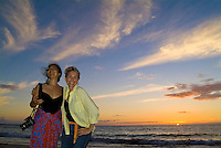 Two women friends at sunset at Maunakea Beach
