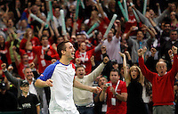 Viktor Troicki of Serbia, right, jubilates after he won the match against Michael Llodra of France, thus making Serbia the winner of the 2010 Davis Cup finals in Belgrade, Serbia, Sunday, Dec. 5, 2010..(Srdjan Stevanovic/Starsportphoto ©)