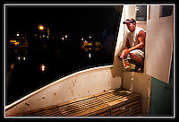 Josh Niklaus takes a moment to himself as he prepares for a long day on the water and, hopefully, a good start to the 2006 commercial lobster season.  Niklaus, a second generation lobsterman, is only a year out of high school, but he has matured quickly as he supports himself and his mother with the proceeds from his lobster boat, The Captain R & R.