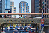 Mid-day traffic passes under the welcome sign on Metro-North Railroad tracks entering the downtown area of White Plains, New York.