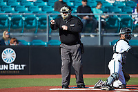 Home plate umpire Craig Mirr makes a strike call during the game between the Illinois Fighting Illini and the Coastal Carolina Chanticleers at Springs Brooks Stadium on February 22, 2020 in Conway, South Carolina. The Fighting Illini defeated the Chanticleers 5-2. (Brian Westerholt/Four Seam Images)