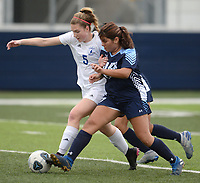 Springdale Har-Ber's Diana Ramos (right) and Rogers' Hattie Hinkle (5) vie for control of the ball Tuesday, April 27, 2021, during the first half of play at Wildcat Stadium in Springdale. Visit nwaonline.com/210428Daily/ for today's photo gallery. <br /> (NWA Democrat-Gazette/Andy Shupe)