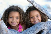 Twin girls enjoy summer fun.
