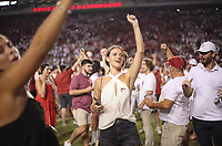 Arkansas fans run out onto the field, Saturday, September 11, 2021 during a football game at Reynolds Razorback Stadium in Fayetteville. Check out nwaonline.com/210912Daily/ for today's photo gallery. <br /> (NWA Democrat-Gazette/Charlie Kaijo)