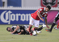 Toluca FC midfielder. Antonio Matias (10) gets fouled by DC United midfielder Andrew Jacobson (8)  Toluca FC defeated DC United 3-1in the Concacaf Champions League tournament,at RFK Stadium Wednesday, August 26  2009.