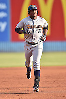 Charleston RiverDogs first baseman Reymond Nunez #36 runs the bases after hitting a home run during a game against the Asheville Tourists at McCormick Field July 29, 2014 in Asheville, North Carolina. The RiverDogs defeated the Tourists 9-3. (Tony Farlow/Four Seam Images)