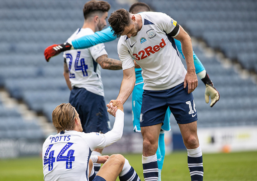 Preston North End's Andrew Hughes (right) helps team mate Brad Potts to his feet at the end of the match <br /> <br /> Photographer Andrew Kearns/CameraSport<br /> <br /> The EFL Sky Bet Championship - Preston North End v Nottingham Forest - Saturday 11th July 2020 - Deepdale Stadium - Preston <br /> <br /> World Copyright © 2020 CameraSport. All rights reserved. 43 Linden Ave. Countesthorpe. Leicester. England. LE8 5PG - Tel: +44 (0) 116 277 4147 - admin@camerasport.com - www.camerasport.com