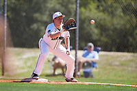 Dartmouth Big Green first baseman Michael Calamari (3) waits for a throw to complete the strikeout during a game against the Villanova Wildcats on March 3, 2018 at North Charlotte Regional Park in Port Charlotte, Florida.  Dartmouth defeated Villanova 12-7.  (Mike Janes/Four Seam Images)