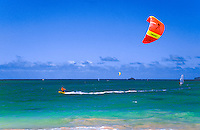 Kite sailing or surfing off Kailua beach, windward Oahu