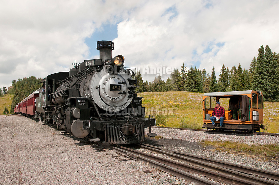 Cumbres & Toltec Scenic Railroad No. 484 (K-36) engine crosses C17 leaving the station at Cumbres Pass and continues on the the narrow-guage track eastbound to Osier, Colo.