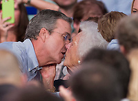 MIAMI, FL - JUNE 15: Jeb Bush looks like hes about to lock lips with mom Barbara Bush. Former Florida Governor Jeb Bush on stage to announce his candidacy for the 2016 Republican presidential nomination at Miami Dade College - Kendall Campus Theodore Gibson Health Center (Gymnasium) June 15, 2015 in Miami, Florida. John Ellis 'Jeb' Bush will attempt to follow his brother and father into the nation's highest office when he officially announces today that he'll run for president of the United States.<br /> <br /> <br /> People:  Jeb Bush, Barbara Bush