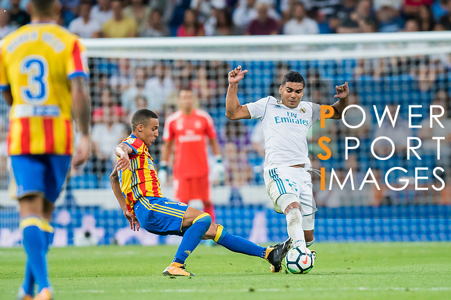 Carlos Henrique Casemiro (r) of Real Madrid fights for the ball with Rodrigo Moreno of Valencia CF during their La Liga 2017-18 match between Real Madrid and Valencia CF at the Estadio Santiago Bernabeu on 27 August 2017 in Madrid, Spain. Photo by Diego Gonzalez / Power Sport Images
