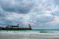 BNPS.co.uk (01202 558833)<br /> Pic: Graham Hunt/BNPS<br /> Date: 2nd September 2021.<br /> <br /> The Red arrows performing their horizontal heart display above the pier on day 1 of Bournemouth Air Festival in Dorset on a warm overcast day.