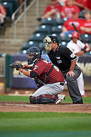 Frisco RoughRiders catcher Jorge Alfaro (8) and umpire Mike Cascioppo during a game against the Springfield Cardinals on June 3, 2015 at Hammons Field in Springfield, Missouri.  Springfield defeated Frisco 7-2.  (Mike Janes/Four Seam Images)