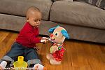 18 month old toddler boy pretend play feeding stuffed toy