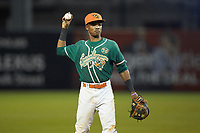 Greensboro Grasshoppers shortstop Jose Devers (2) warms up between innings of the game against the West Virginia Power at First National Bank Field on June 1, 2018 in Greensboro, North Carolina. The Grasshoppers defeated the Power 10-3. (Brian Westerholt/Four Seam Images)