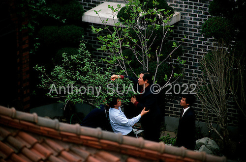 """Seoul, South Korea<br /> June 1, 1987<br /> <br /> Kim Dea-jong (trimming tree) in his backyard under house arrest as opposition leader to the ruling party. <br /> <br /> <br /> Kim Dae-jung (3 December 1925 to 18 August 2009) was President of South Korea from 1998 to 2003, and the 2000 Nobel Peace Prize recipient. As of this date Kim is the first and only Nobel laureate to hail from Korea. A Roman Catholic since 1957, he has been called the """"Nelson Mandela of Asia"""" for his long-standing opposition to authoritarian rule."""