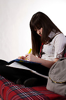 CANADA -  Feb 2010- Model Released photo of an 11 year old female teenagerCANADA -  Feb 2010- Model Released photo of an 11 year old female student teenager doing her homework