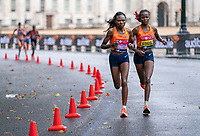 4th October 2020, London, England; 2020 London Marathon; Ruth Chepngetich (KEN) and Brigid Kosgei (KEN) run past Horse Guards Parade during the Elite Women's Race in the rain. The historic elite-only Virgin Money London Marathon taking place on a closed-loop circuit around St James's Park in central London on Sunday 4 October 2020.