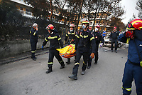 Pictured: Firemen carry a dead body in the Mati area, Kokkino Limanaki near Rafina, Greece. Tuesday 24 July 2018<br /> Re: Deaths caused by wild forest fires throughout Greece.