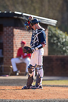 Shippensburg Raiders catcher Jake Kennedy (30) on defense against the Belmont Abbey Crusaders at Abbey Yard on February 8, 2015 in Belmont, North Carolina.  The Raiders defeated the Crusaders 14-0.  (Brian Westerholt/Four Seam Images)
