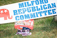 A sign for the Milford Republican Committee stands above a pack of Twizzlers before the Labor Day parade in Milford, New Hampshire. Republican candidates John Kasich, Carly Fiorina, and Lindsey Graham, and Democratic candidate Bernie Sanders marched in the parade.