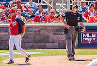 25 July 2013: MLB Umpire and Crew Chief Mike Winters watches Manager Davey Johnson leave the field after he ejected him for arguing balls and strikes during a game between the Pittsburgh Pirates and the Washington Nationals at Nationals Park in Washington, DC. The Nationals salvaged the last game of their series, winning 9-7 ending their 6-game losing streak. Mandatory Credit: Ed Wolfstein Photo *** RAW (NEF) Image File Available ***