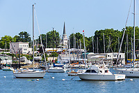 Sailboats and other pleasure craft moored in the East Basin of Mamaroneck Harbor in Harbor Island Park located in Mamaroneck, New York.