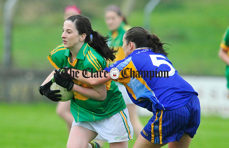 Kilmihil's Miriam Frawley pushes past the challenge of Fergus Rover's Teresa Meaney. Photograph by Declan Monaghan