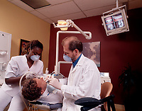 Montreal (Qc) CANADA , Model releases photo-<br /> Dentist at work<br /> photo : (c) images Distribution
