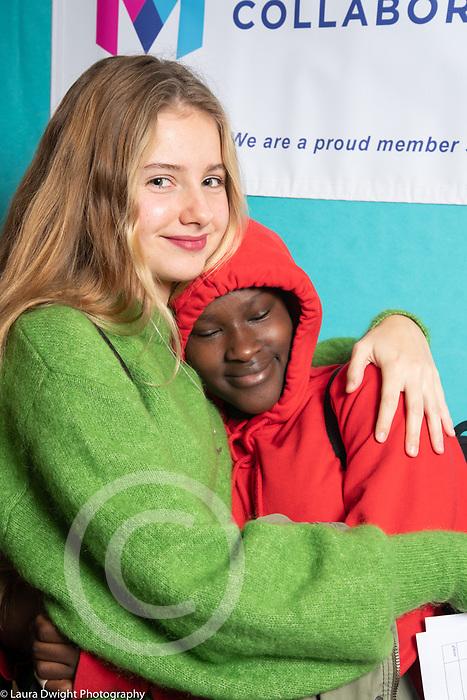 Education High School twp girls hugging