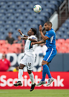 DENVER, CO - JUNE 19: Joris Marveaux #3 and Aricheell Hernandez #10 vie for the header during a game between Martinique and Cuba at Broncos Stadium on June 19, 2019 in Denver, Colorado.