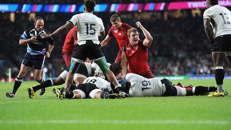 Joe Launchbury of England celebrates the last minute try scored by Mako Vunipola of England during Match 1 of the Rugby World Cup 2015 between England and Fiji - 18/09/2015 - Twickenham Stadium, London <br /> Mandatory Credit: Rob Munro/Stewart Communications