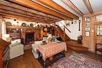 BNPS.co.uk (01202) 558833. <br /> Pic: TimHardy/KnightFrank/BNPS<br /> <br /> Pictured: Cozy sitting room. <br /> <br /> A traditional country cottage in a hidden valley surrounded by its own woodland is on the market for offers over £700,000.<br /> <br /> Beck Cottage sits in a stunning position with a stream that has fishing rights and an idyllic private natural pool with a waterfall.<br /> <br /> Estate agent Knight Frank say it is a rare opportunity for someone to get their own bit of unspoilt England as the cottage is on the market for the first time in about 70 years.<br /> <br /> The five-bedroom property is close to the seaside town of Whitby and the North York Moors National Park.