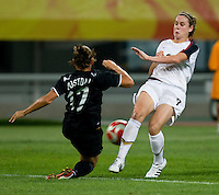 Heather O'Reilly, Marlies Oostdam. The USWNT defeated New Zealand, 4-0, during the 2008 Beijing Olympics in Shenyang, China.  With the win, the USWNT won group G and advanced to the semifinals.