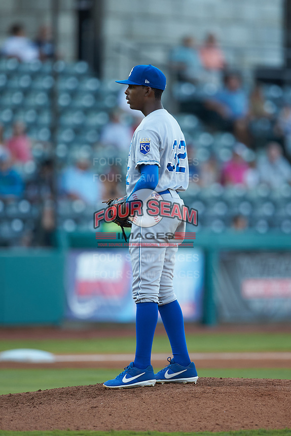 Burlington Royals starting pitcher Adrian Alcantara (32) looks to his catcher for the sign against the Pulaski Yankees at Calfee Park on August 31, 2019 in Pulaski, Virginia. The Yankees defeated the Royals 6-0. (Brian Westerholt/Four Seam Images)