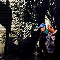 Mexican women walk along the street during a sunny morning in Buenavista, a neighborhood in Mexico City, Mexico, 29 October 2016.