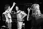 """Paul and Linda McCartney Wings Tour 1975. Linda takes a photograph of Paul at the rehearsal studio Elstree. Roadie Trevor Jones talks with Paul. The photographs from this set were taken in 1975. I was on tour with them for a children's """"Fact Book"""". This book was called, The Facts about a Pop Group Featuring Wings. Introduced by Paul McCartney, published by G.Whizzard. They had recently recorded albums, Wildlife, Red Rose Speedway, Band on the Run and Venus and Mars. I believe it was the English leg of Wings Over the World tour. But as I recall they were promoting,  Band on the Run and Venus and Mars in particular."""