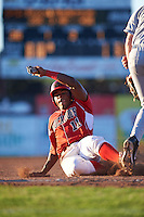 Batavia Muckdogs outfielder Stone Garrett (11) slides into third during a game against the Mahoning Valley Scrappers on June 23, 2015 at Dwyer Stadium in Batavia, New York.  Mahoning Valley defeated Batavia 11-2.  (Mike Janes/Four Seam Images)