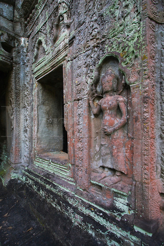 A stone carved bas relief of an Apsara (celestial mainden) at Ta Prohm, built by Jayavarman VII & part of the  Angkor Wat temple complex - Siem Reap, Cambodia...