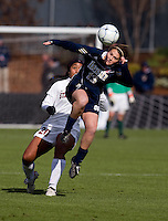 Courtney Barg (13) of Notre Dame heads the ball in front of Mariah Nogueira (20) of Stanford during the final of the NCAA Women's College Cup at WakeMed Soccer Park in Cary, NC.  Notre Dame defeated Stanford, 1-0.