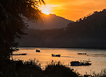 A sunset over the Mekong River, as viewed from the outdoor riverside cafe of the Belle Rive Hotel in Luang Prabang, Laos.