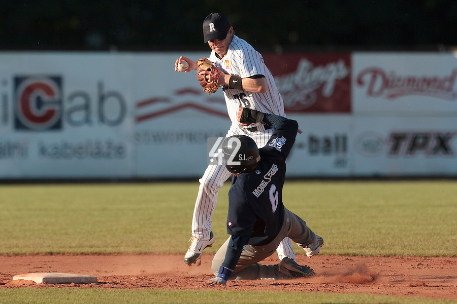 05 June 2010: Aaron Hornostaj of Rouen is kicked by Juan Carlos Infante of Bologna (interference will be called) during the 2010 Baseball European Cup match won 10-0 by Fortitudo Bologna over the Rouen Huskies, at the AVG Arena, in Brno, Czech Republic.