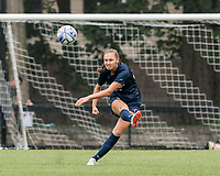 NEWTON, MA - AUGUST 29: Evelyn Arsenault #23 of University of Connecticut passes the ball during a game between University of Connecticut and Boston College at Newton Campus Soccer Field on August 29, 2021 in Newton, Massachusetts.