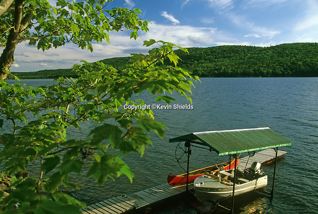 Boats at a dock on Long Lake, T17 R3 WELS, Maine, USA