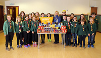Sarah Pudsey, Aldi Store Manager (CENTRE IN BLUE) with children from the scout group