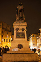 """A crowd gathered in Piazza Farnese in front of the French Embassy for a candlelight vigil in  solidarity with the victims of the attack against the headquarters of the satirical magazine Charlie Hebdo, which resulted in the killing of 12 in Paris. The event  has been promoted by the National Federation of the Italian Press (FNSI) and Articolo21. """"Je suis Charlie"""" banners on the Giordano Bruno statue, martyr for free thought. Rome, Italy. Jan 8, 2015"""